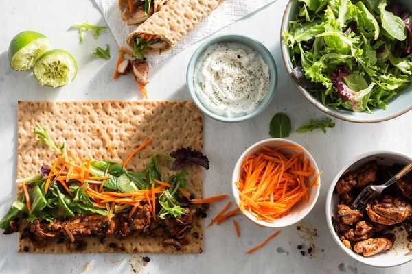 Musakhan chicken wraps with pickled carrots and lemon-dill yogurt