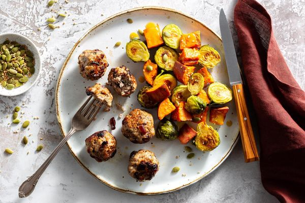 Turkey-cranberry meatballs with roasted Brussels sprouts and sweet potato