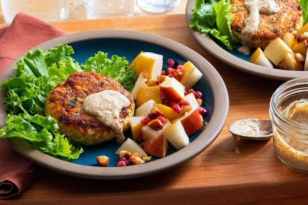 Speedy lettuce-wrapped salmon burgers with fall fruit salad