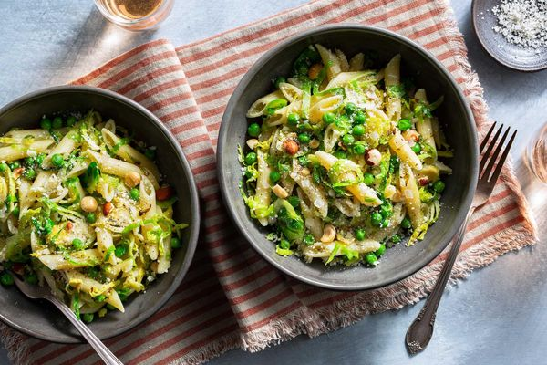 Brussels sprout carbonara with penne rigate and roasted hazelnuts