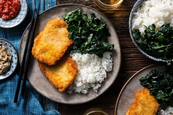 Pork katsu with black garlic mayo, wilted greens, and jasmine rice
