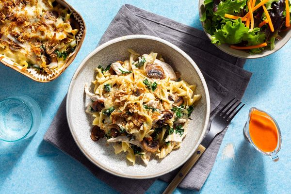 Cheesy chicken tetrazzini with mushrooms and a green salad
