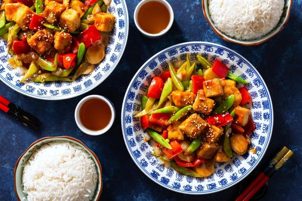 Sweet and sour tofu with water chestnuts, snap peas, and white rice