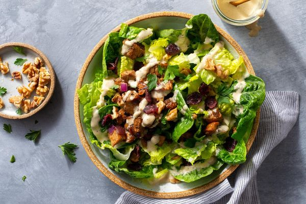 Pork chop salad with dried cranberries, walnuts, and Caesar dressing