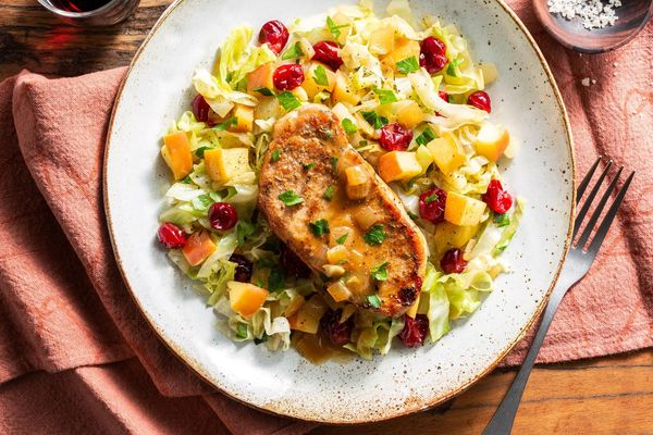 Spiced pork chops with braised apple, cabbage, and cranberries